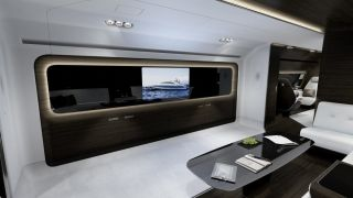 That wraparound couch faces a TV screen that is integrated into a black panel. You could also switch the TV off and make that panel transparent to gaze at the open sky.  Mercedes-Benz