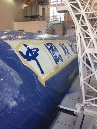 China United Airlines is repainting an eye-catching livery on a Boeing 737-800 aircraft (B-5665).
