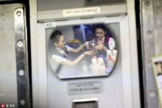 Liu Miaomiao, left, and her colleague prepare the meals in the onboard kitchen. [Photo/IC]