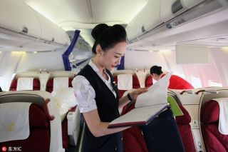 Liu Miaomiao checks the maintenance report of the aircraft technical log of the plane bound for Beijing. [Photo/IC]