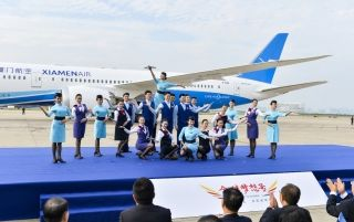 Xiamen Airlines' flight attendants welcomed the first Boeing 787-9 Dreamliner, Registration B-1566, at Xiamen Gaoqi International Airport on Dec. 8, 2016.