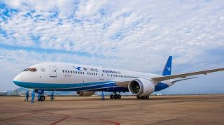Xiamen Airlines' first Boeing 787-9 Dreamliner, Registration B-1566, touched down at Xiamen Gaoqi International Airport at 3:30 p.m. on Dec. 8, 2016.