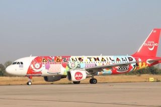 "Thai AirAsia has unveiled a brand new aircraft livery - a silk cloth pattern with the words ""Amazing Thailand"" on the fuselage, as part of the Tourism Authority of Thailand's 2017 promotion. (Photo by Jakrapan Nathanri)"