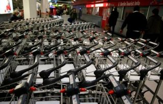 Empty luggage carts are pictured during a warning strike by ground services, security inspection and check-in staff at Tegel airport in Berlin, Germany, March 10, 2017. REUTERS/Hannibal Hanschke