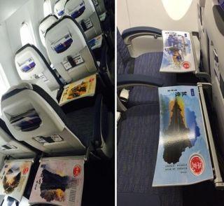 服务升级新举措 华夏航空机上特色小桌板上线