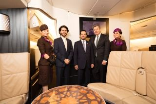(From left to right) Flanked by Etihad Airways cabin crew, Etihad Airways' Executive Vice President Commercial, Mohammad Al Bulooki; the Ambassador of the United Arab Emirates to France, H.E Maadhad Hareb Meghair Jaber Alkhyeli; Executive Director, Chief Airport Operations Officer and Paris-Charles de Gaulle Airport Managing Director, Franck Goldnadel