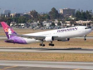 美国乘客飞机上醉酒闹事被罚9.8万美元