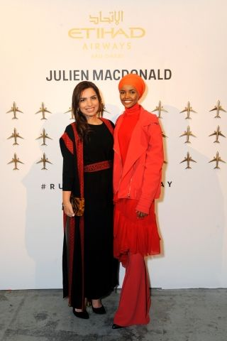 Amina Taher, Etihad Aviation Group Vice President Corporate Affairs; and Model Halima Aden toast the launch of Etihad Airways' promotional fashion film 'Runway To Runway' at NYFW: The Shows in New York City
