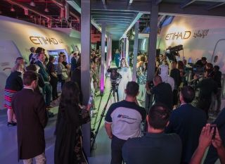 Models walk down the catwalk at Etihad Airways Innovation Training Academy