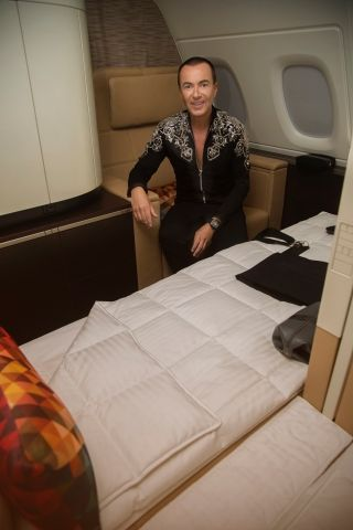 Designer Julien Macdonald sits in a mock-up of the A380 First Class Apartment