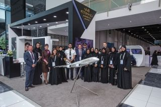 Etihad Aviation Group employees are proudly pictured on Etihad Airways' stand during WorldSkills Abu Dhabi 2017 at the Abu Dhabi National Exhibition Centre