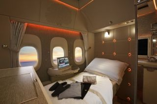 The fully flat bed of Emirates 777 First Class cabin.