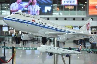 """40余架飞机""""机队""""助阵 国航系产品亮相机场"""