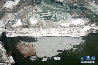 航拍雪后大明湖。图/新华社