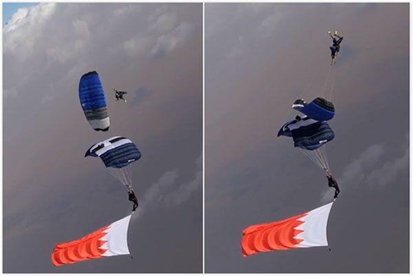 挑战极限!男子乘滑翔伞成功从同伴上方翻越