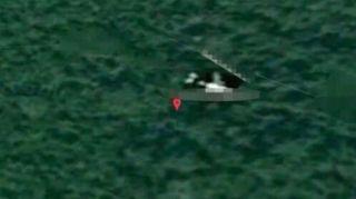 英专家称发现MH370:在柬埔寨密林 机身似有缺口