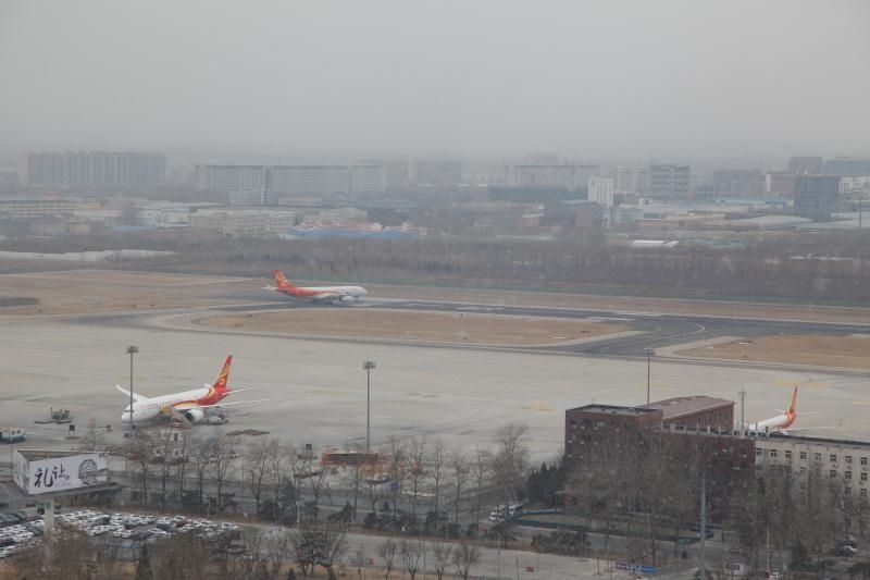 首都机场持续零星小雪天气  目前运行秩序正常