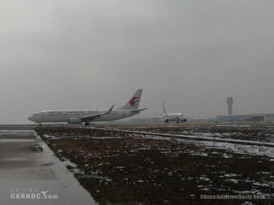 合肥机场未受下雪影响 航班起降正常