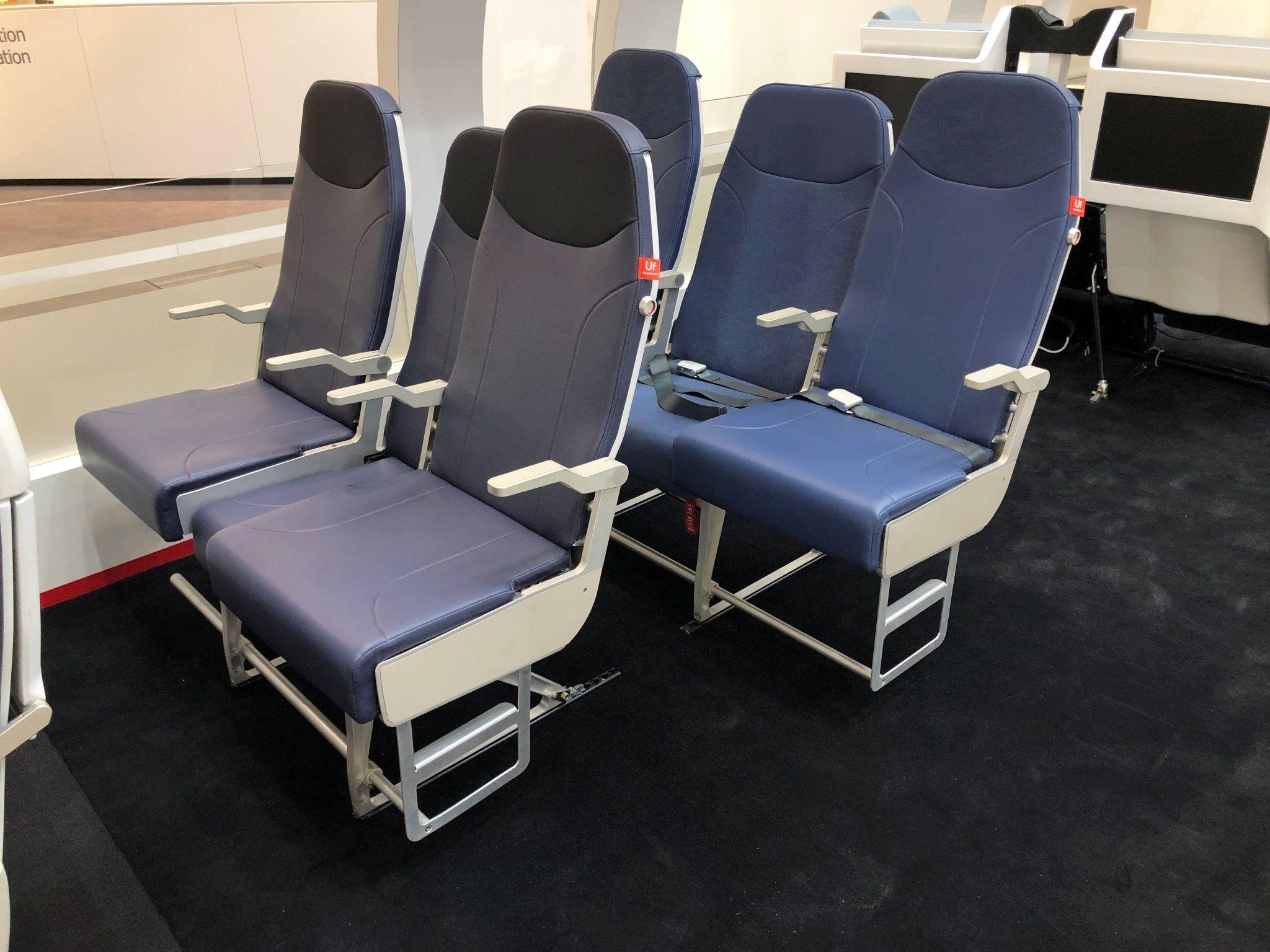 新款可移动性飞机座椅面世 中间位退后解决手肘之争