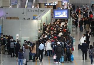 春节来临 韩国仁川机场迎出行高峰